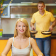Stock Photo: Young couple at breakfast in kitchen