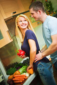 A young couple in kitchen — Stock Photo