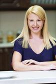 Happiest girl in kitchen — Stock Photo