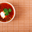 Bowl of borscht on bamboo table cloth - 图库照片