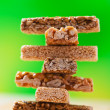 Tower of sweets on green background — Stock Photo #7826243