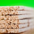 Dietetic loaves on green background — Stock Photo