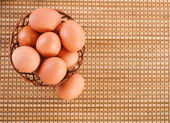 Still Life-eggs in wicker basket — Stock Photo