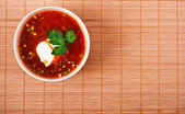 Bowl of borscht on bamboo table cloth — 图库照片