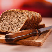 Rye bread on kitchen table — Stock Photo