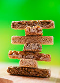 Tower of sweets on green background — Stock Photo