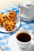 Breakfast: Black coffee with pastries — Stock Photo