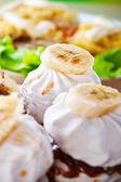 Marshmallows decorated banana — Stock Photo