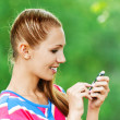 Woman with mobile phone in hand — Stock Photo