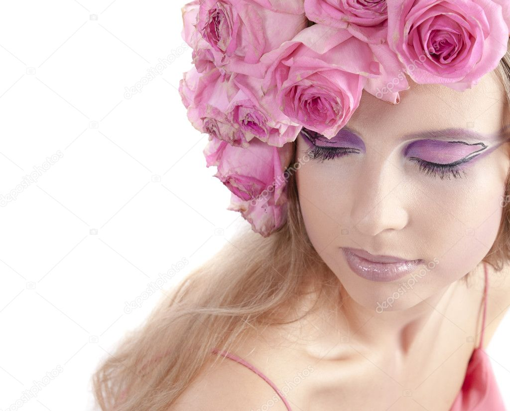 Young beautiful woman with pink flowers on her head over white — Stock Photo #6776282