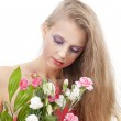 Young beautiful woman with flowers — Stock Photo
