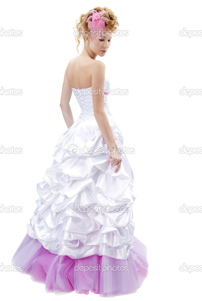 Beautiful girl in wedding dress isolated on white — Stock Photo #6915809
