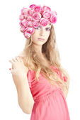 Young beautiful woman with pink flowers — Stock Photo