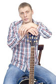 Young handsome man with guitar — Stock Photo