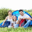 Family with a child in a tent — Stock Photo