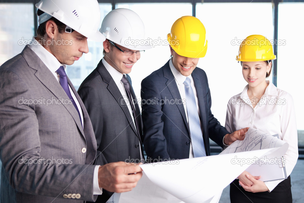 Business in hard hats at construction site — Stock Photo #7040114