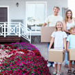 Family with boxes in the house — Stock Photo #7207465