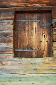 Wall of ancient wooden barn — Stock Photo