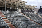 Rows of empty black plastic seats — Stock Photo