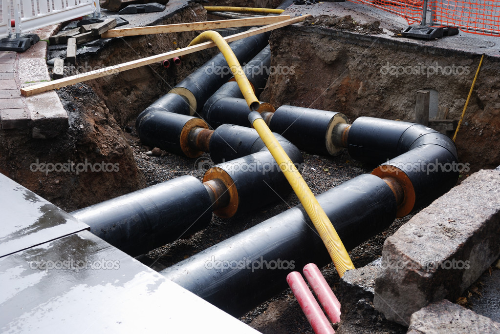 Construction of water supply, pipe in the trench  Stock Photo #7495442