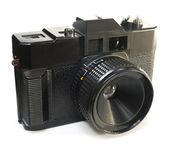 Black primitive plastic camera — Stock Photo
