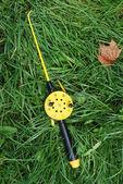 Fishing rod with yellow reel — Stock Photo