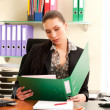 Business woman sitting in the office — Stock Photo