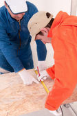 Construction worker doing measuring — Stock Photo