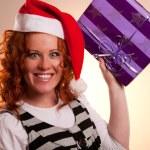 Christmas santa woman holding gift — Stock Photo