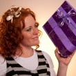Beautiful excited girl with a presents — Stock fotografie