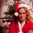Funny looking bad santa girl — Stockfoto