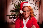 Funny looking bad santa girl — Stock Photo