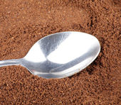 Milled coffee and one teaspoon — Stock Photo