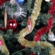 Toys on green christmas fir — Photo