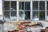 Broken window at the wall — Stock Photo
