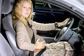 Pregnant women in car — Stock Photo