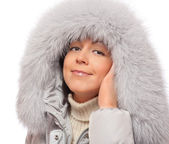 Young woman in fluffy hood — Stock Photo