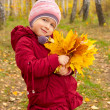Little girl with yellow leaves — Stock Photo #7153422