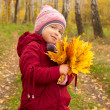 Little girl with yellow leaves — Stock Photo #7182929