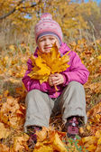 Little girl with yellow leaves — Stock Photo