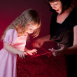 Royalty-Free Stock Photo: Mother give gift to her daughter