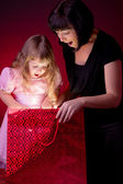 Mother give gift to her daughter — Stock Photo