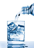 Water pouring to glass — Stock Photo