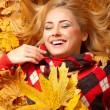 Young woman with autumn leaves — Stock Photo #7548746