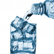 Water pouring from bottle to glass — Stock Photo