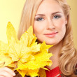 Woman with autumn leaves — Stockfoto
