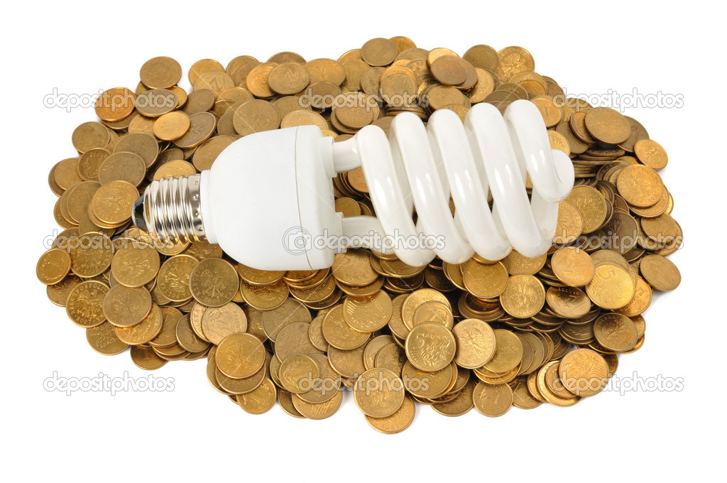 Energy saving light bulb and stacks of coins isolated on white  Stock Photo #6944297