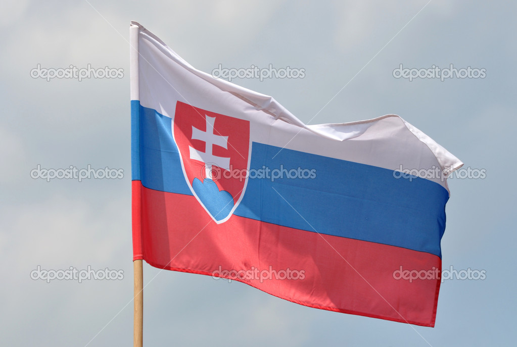 Flag of Slovakia against blue sky  Stock Photo #6944327