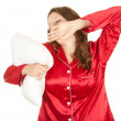 Yawning girl in red pajamas — Stock Photo