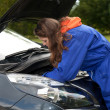 Female car mechanic with in action — Stock Photo